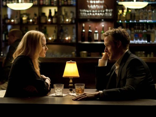 Ryan Gosling and Evan Rachel Wood in a restaurant scene from The Ides of March movie