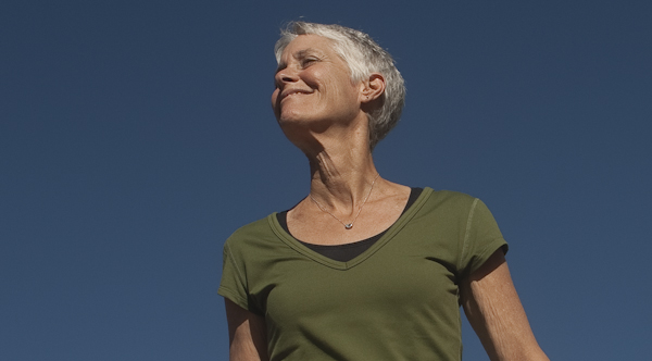 Los Angeles photography of cancer survivor smiling while running outside for photographer