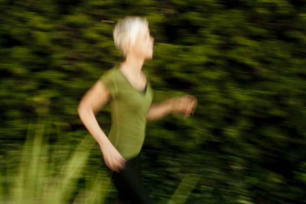 Los Angeles woman running fast for the photographer during a shoot about cancer survivors