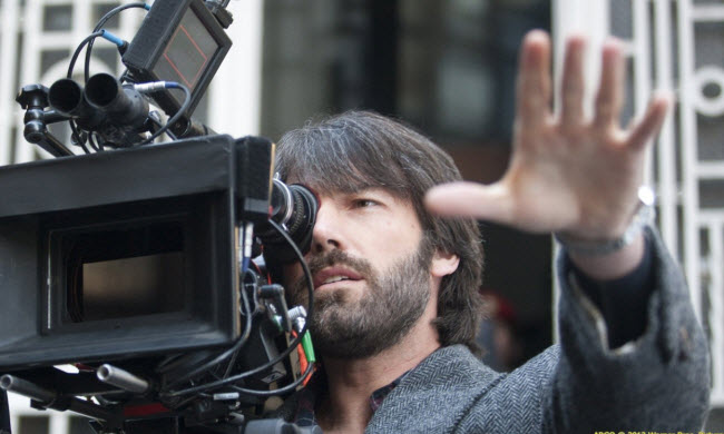 Argo-movie-director Ben Affleck at film camera on set
