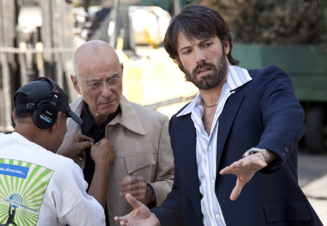 Argo movie director Ben Affleck giving direction to actor Alan Arkin in scene preparation and discuss script