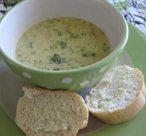 Panera Bread broccoli cheese soup recipe shows soup in bowl with bread slices