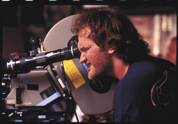 Quentin Tarantino writer of Django Unchained script on the set looking in movie camera