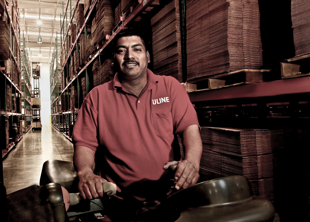 A forklift operator was photographed in Los Angeles warehouse for Uline corporate annual report publication