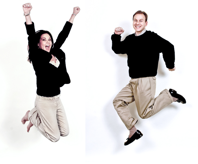 Jumping business executive man and woman in photo shot by corporate Los Angeles photographer
